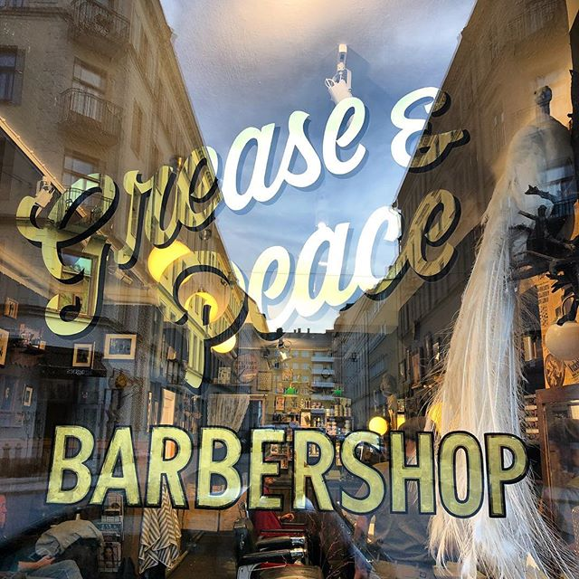 The front window is done  . @barber_vonsven killed it today. 24 gold leaf. @greaseandpeace barbershop ,come on over and get that cut . Peace ️