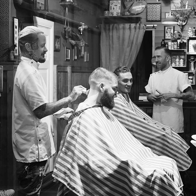 super candid shot of dudes getting haircuts and discussing serious business . photo by the one and only @michelxedge #barberlife #americantraditionalbarbershop #stockholmbarber #mensbarbershop #traditionalbarber